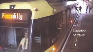 Man with hand caught in tram door