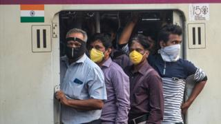 Passengers on a train in Mumbai