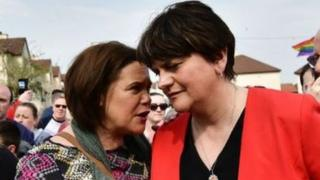 Sinn Féin president Mary Lou McDonald and Democratic Unionist Party leader Arlene Foster at the vigil in Londonderry