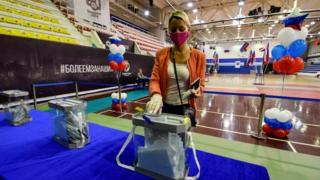 A woman votes in Vladivostok on Russia's constitutional reforms