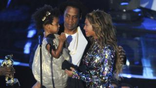 This Aug 24, 2014 file photo shows Beyonce on stage with Jay Z and their daughter Blue Ivy as she accepts the Video Vanguard Award at the MTV Video Music Awards in Inglewood, Calif.