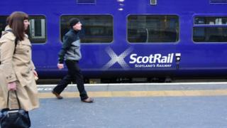 A ScotRail train alongside a platform as rail services continue to attract criticism in the wake of fare increases