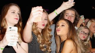 Ariana Grande with fans in 2014