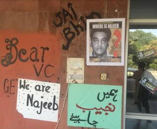 Posters showing campaigns to help the police find Najeeb Ahmed