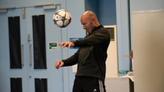 Alan Shearer heading a ball