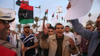 Supporters of PM-designate Fayez al-Sarraj rally in Tripoli's Martyrs' Square 31 March 2016