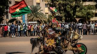 A man rides a decorated motorbike on the sideline of the last stage of the 32nd edition of the Tour du Faso 2019 cycling race, in Ouagadougou, on November 3, 2019. (