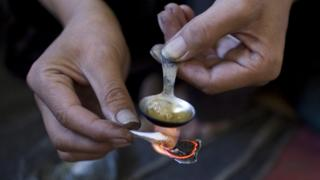 Heroin being mixed by a drug user, file pic