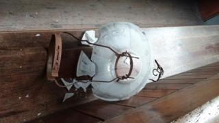 A damaged lamp at St Mary's Church, Llanfair Kilgeddin