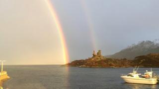 Castle Moil and rainbow before the lightning strike