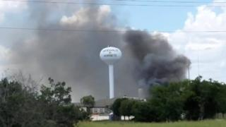 Smoke rises above the Coryell Memorial Hospital in Gatesville, Texas