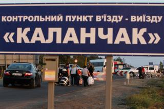 "20 September, 2015 People carrying their goods are seen crossing the border between the mainland of Ukraine and the annexed territory of Crimea. Chairman of the Mejlis of the Crimean Tatar people Refat Chubarov initiated the transport blockade of the administrative border of the Kherson region and the Crimea from noon September 20 with the aim to cut off supplies of food and other products from the mainland to the annexed territory. Strategic goal: the returning of the Crimea under the control of the Ukrainian authorities. Mr. Chubarov does not rule out that after the ""food blockade"" of the annexed Crimea, the Crimean Tatars will seek an end to the supply of electricity to the peninsula."