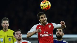 Arsenal's French midfielder Mathieu Flamini wins a header during the English Premier League football match between Arsenal and Chelsea at the Emirates Stadium in London on January 24, 2016