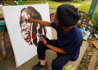 Man drawing on a canvas