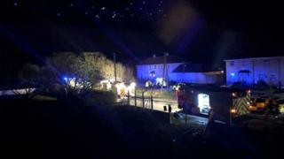 An image of emergency services at the scene of the crash on the A38 Bristol Road