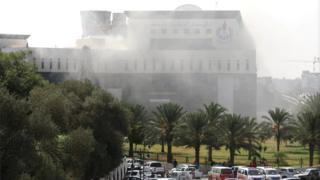 Smoke rises form the headquarters of Libyan state oil firm National Oil Corporation (NOC) on 10 September 2018