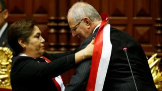 Pedro Pablo Kuczynski receives the presidential sash from President of Congress Luz Salgado