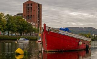 Brigher Hope, photographed at low tide on the River Leven with the old mill building in the background,