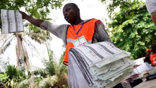 Man with ballot papers in Lagos