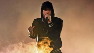 Eminem tops both UK album and singles charts