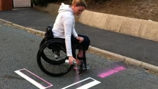 Claire Lomas sprays her own disabled space