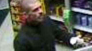 CCTV image of a man police want to speak to in connection with a fire at Housing Options in Swansea