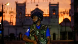"A security officer stands guard outside St. Antony""s Shrine, days after a string of suicide bomb attacks on churches and luxury hotels across the island on Easter Sunday, in Colombo"