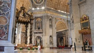 """Pope Francis reads his """"Urbi et Orbi"""" (""""To the City and the World"""") message in St. Peter's Basilica"""
