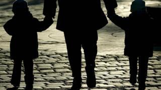 Children walking with parent