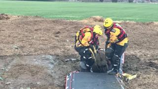 Fire service rescuing a man