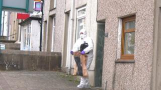 Scenes of crime officer at Water St, Penygroes