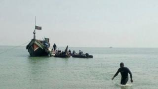 The boat being pulled ashore