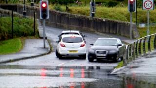 Motorists turn their cars around to avoid driving the flooded Irishtown Road in Omagh