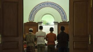 Indonesian men pray at a fundamentalist mosque on February 3, 2016 in Solo, Indonesia.