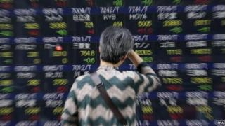Woman looking at Japan share board
