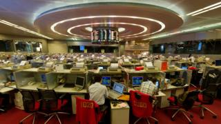 Traders work on the floor of the Hong Kong Stock Exchange