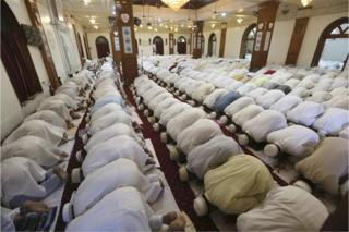 Members of the Dawoodi Bohra community perform namaz, or prayers, at a mosque in Bhopal, India, 14 June 2018