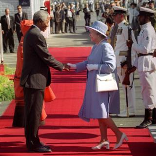 South Africa's President Nelson Mandela greets Queen Elizabeth II