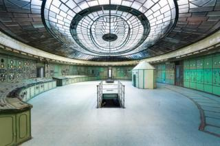 A control room in a power station with a glass-panelled ceiling