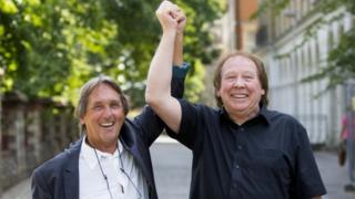 """Leonard """"Chip"""" Hawkes (left) and Richard Westwood, who were members of the 1960s pop group The Tremeloes, celebrate outside Reading Crown Court after being formally acquitted"""
