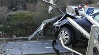 Car on bridge crashed through barrier