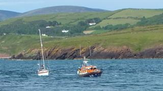 Peel lifeboat towing a yacht