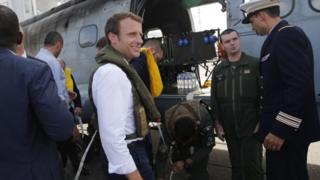 French President Emmanuel Macron comot for helicopter wey bring am