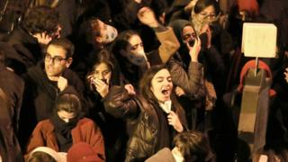 Iranian students chant slogans as they demonstrate