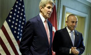 Turkish Foreign Minister Mevlut Cavusoglu and US Secretary of State John Kerry in Malaysia on 5 August 2015