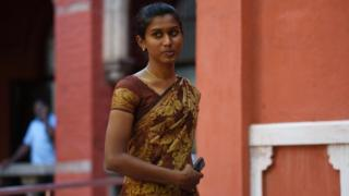 "Indian policewoman K Prithika Yashini, 25, leaves after a judgement cleared legal hurdles allowing her to become India""s first transgender Sub Inspector of Police at the Madras High Court on November 6, 2015."