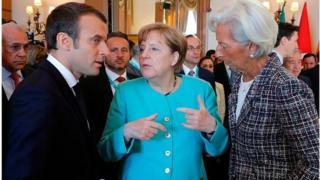 Angela Merkel a taron G7