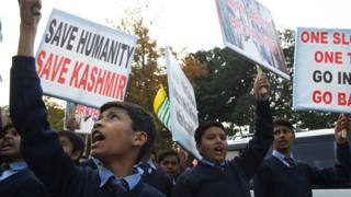 Pakistani children shout anti-Indian slogan during a protest against the lockdown in Indian-controlled Kashmir in Islamabad on December 10, 2019, on Human Rights day