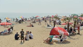 People on the beach at Clacton-on-Sea