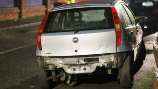 Car damaged by explosion